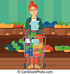 Woman with shopping list. - A thoughtful woman standing with...
