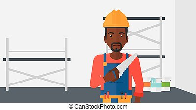 Smiling worker with saw.