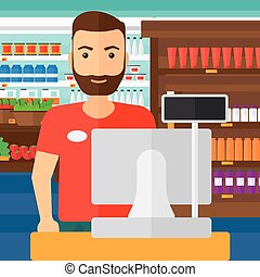 Salesman standing at checkout - A salesman standing at...