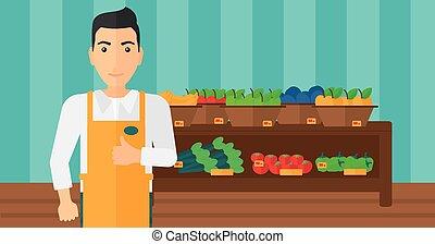 Friendly supermarket worker - A supermarket worker showing...