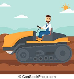 Farmer driving catepillar tractor - A hipster man with the...