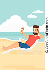 Man sitting in chaise longue. - A hipster man with the beard...