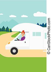 Woman driving motor home - A woman driving a motor home in...