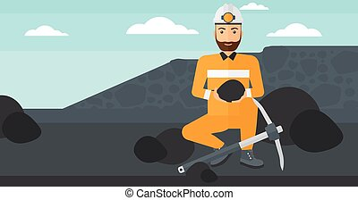 Miner holding coal in hands - A hipster man sitting with...