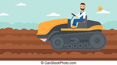Farmer driving catepillar tractor. - A hipster man with the...