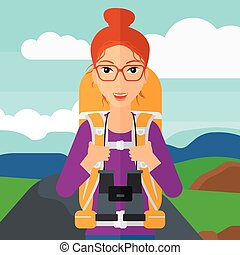 Cheerful backpacker with binoculars. - A woman with backpack...
