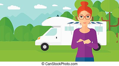 Woman standing in front of motor home - A woman standing on...