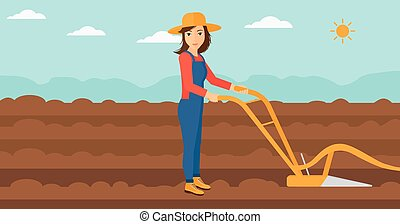Farmer on the field with plough - A woman using a plough on...