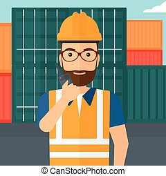 Stevedore standing on cargo containers background. - A man...