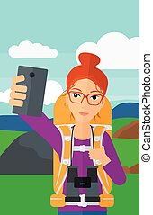 Backpckaer making selfie. - A woman making selfie on the...