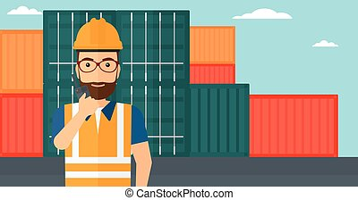 Stevedore standing on cargo containers background - A man...