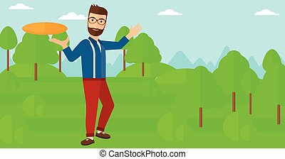 Man playing frisbee. - A hipster man with the beard playing...
