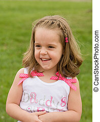 Little Girl Playing Outside With Big Smile