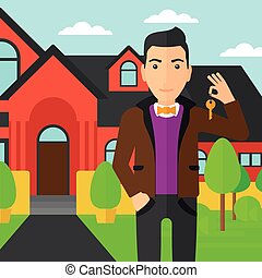 Real estate agent with key. - A real estate agent holding...