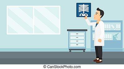 Doctor examining radiograph - A doctor examining a...