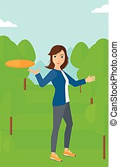 Woman playing frisbee. - A woman playing frisbee on the...