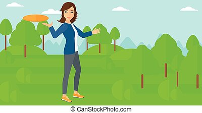 Woman playing frisbee - A woman playing frisbee on the...