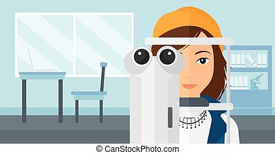 Patient visiting ophthalmologist - A woman during eye examon...