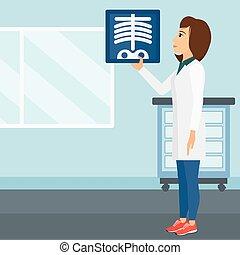 Doctor examining radiograph. - A doctor examining a...