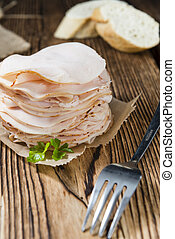 Chicken Breast Fillet selective focus on an vintage wooden...