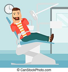 Frightened patient in dental chair - A frightened hipster...