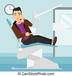 Man suffering in dental chair - A man sitting in chair in...
