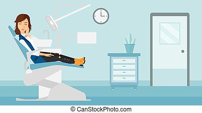 Woman suffering in dental chair - A woman sitting in chair...