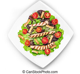 Caesar salad dish close up. Isolated on a white background.