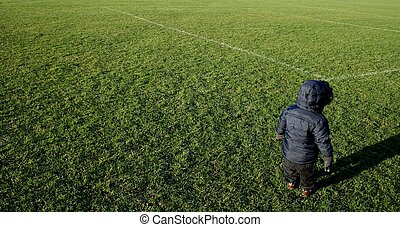 Toddler on football pitch