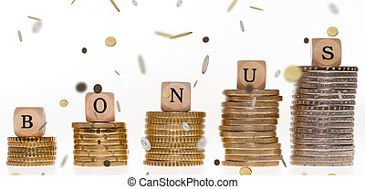 Bonus - Stack of coins and wood dice with the word bonus