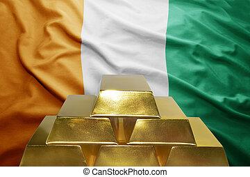 ivorian gold reserves - shining golden bullions on the...