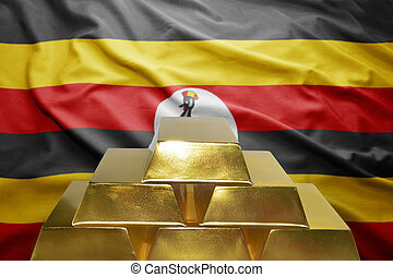 ugandan gold reserves - shining golden bullions on the...