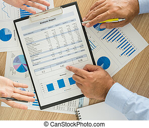financial - Businessman analyzing financial data of the...