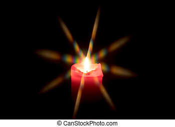 Candle light over a dark background
