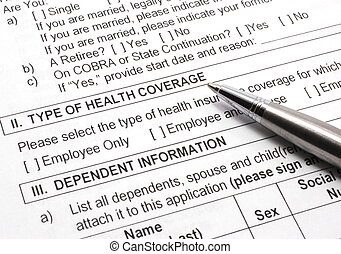 Health Insurance Application with Pen - Close-up photograph...