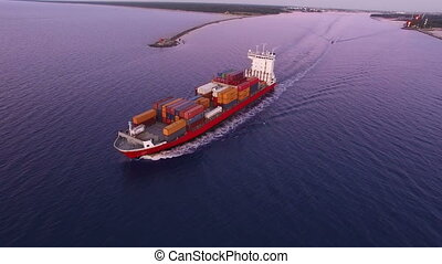 HD - To follow the cargo ship. Aerial view