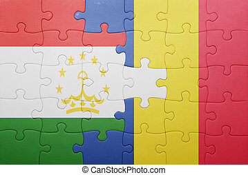 puzzle with the national flag of tajikistan and romania ....