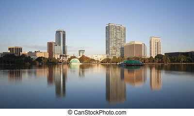 4K Time lapse zoom in Orlando skyline from Lake Eola -...