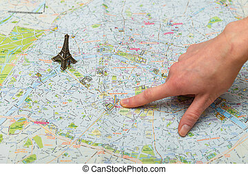 She points to the next point of interest on the map. planning your trip.