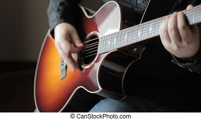 Man playing acoustic guitar - Guitarist playing acoustic...