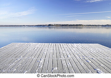 Snowy pier for boats on a frozen Istra reservoir - Istra...