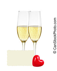 Two glasses of champagne, greeting card and red heart...