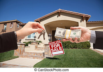 Handing Over Cash For House Keys and Short Sale Sign -...