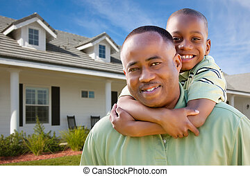 Father and Son Outside of Home - Happy African American...