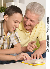 Grandfather With Grandson Reading