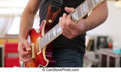 Playing the electric guitar on stage