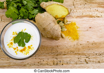 Glas Indian traditional lassi with spices, copy space -...