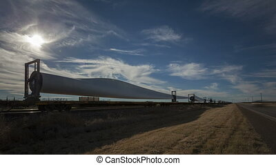 4K Time lapse windmill blades on cargo train with highway -...