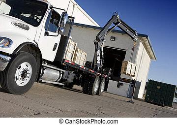 crane delivering box - crane in operation delivering wooden...