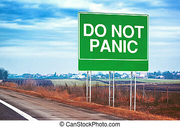 Do not panic road sign by the freeway, supportive message...